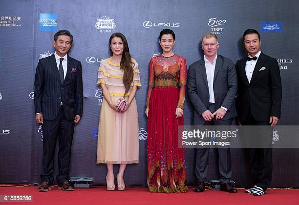 Tenniel Chu and his wife Carmen English Football Player Paul Scholes and Actress Charmaine Sheh walk the Red Carpet event at the World Celebrity...