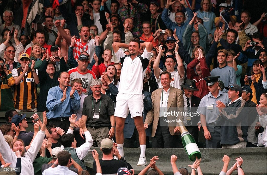 Tennis, 2001 All England Lawn Tennis Championships, Wimbledon, 9th July 2001, Mens Singles Final, Croatia's Goran Ivanisevic celebrates with his father Srdjan (with white hair) and other supporters after becoming the Mens Singles Champion, despite being a wild card entry