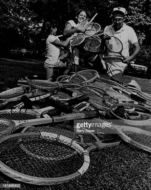SEP 3 1970 SEP 9 1970 Tennis Anyone for Tennis Cathy Weisbart Nancee Bershof and Irwin Hoffman gather rackets collected at Green Gables Country Club...