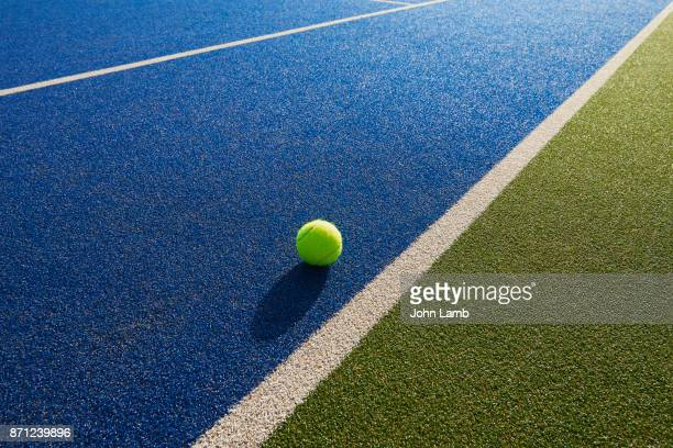 Tennis  ball and net shadow