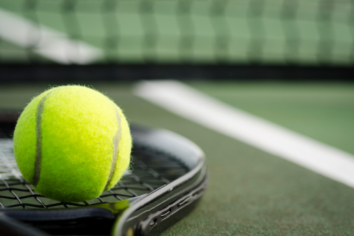 Tennis Ball and Racket on the Court Horizontal 155418909