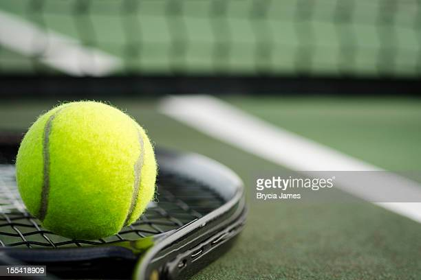 tennis ball and racket on the court horizontal - tennis ball stock pictures, royalty-free photos & images