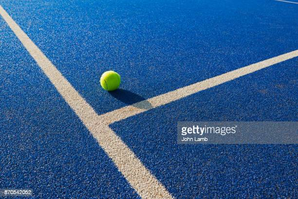 tennis  ball and service line - blue stock pictures, royalty-free photos & images