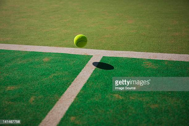 tennis ball bouncing on court - bouncing ball stock photos and pictures