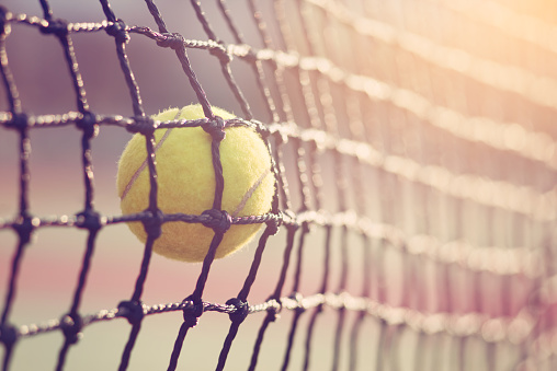 Tennis ball hitting the tennis net at tennis court with copy space. 870506492
