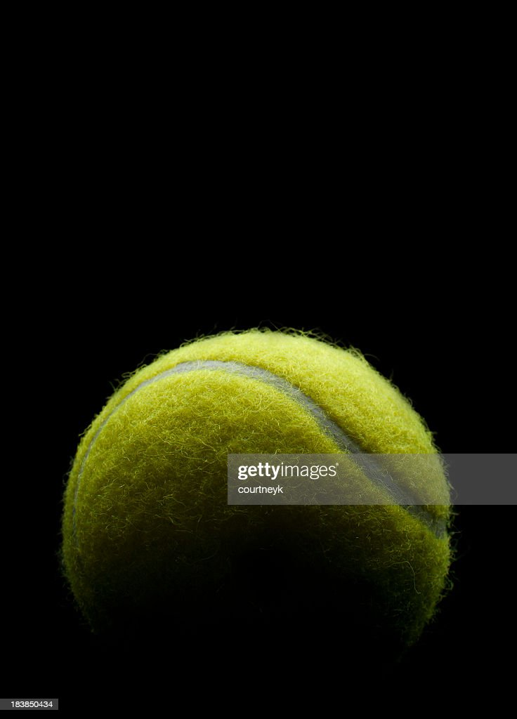 Tennis Ball On A Black Background Stock Photo Getty Images