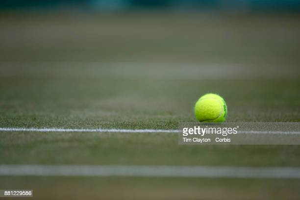 A tennis ball on a grass court during the Wimbledon Lawn Tennis Championships at the All England Lawn Tennis and Croquet Club at Wimbledon on July 10...
