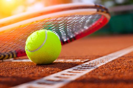 .tennis ball on a tennis court 513920615