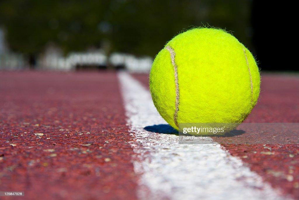 Tennis ball on tennis court : Stock Photo