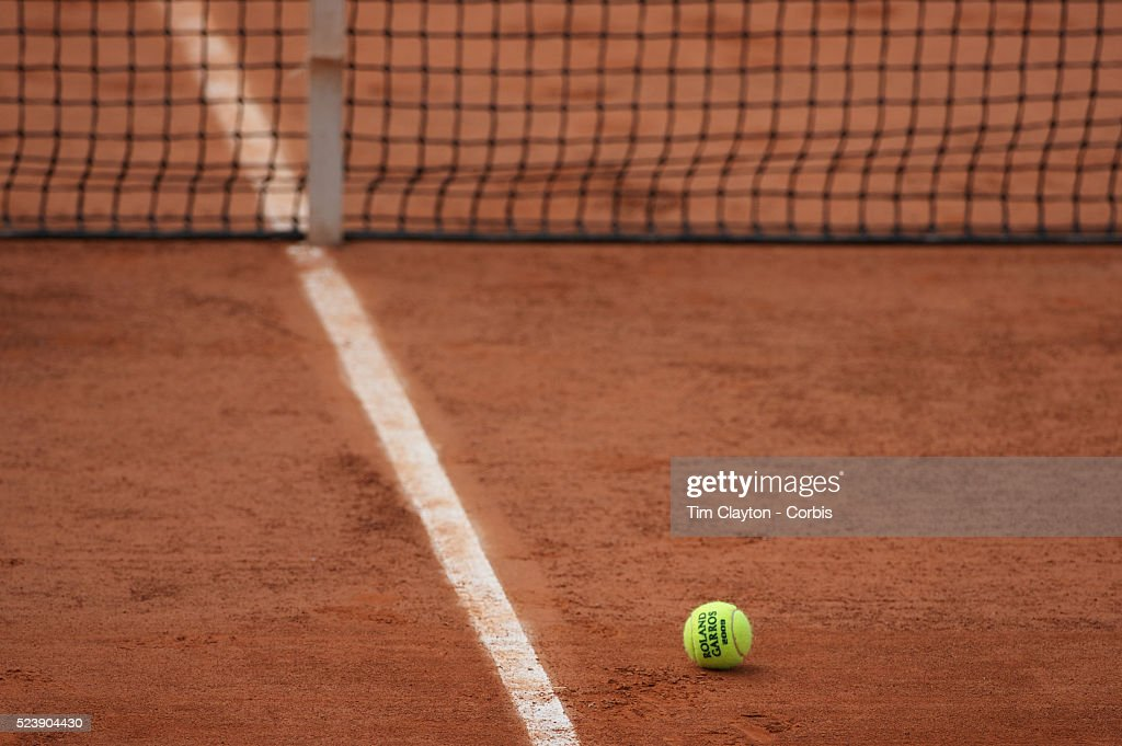 'A tennis ball on the clay surface of Roland Garros during practice before the start of the French Open Tennis Tournament in Paris, France on Saturday, May 23, 2009. Photo Tim Clayton '