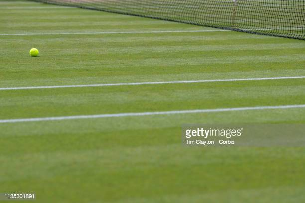 A tennis ball on the grass court during the Wimbledon Lawn Tennis Championships at the All England Lawn Tennis and Croquet Club at Wimbledon on July...