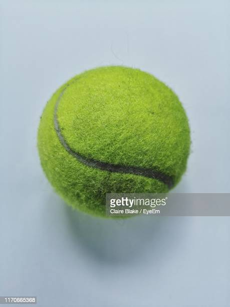 tennis ball on white background - tennis ball stock pictures, royalty-free photos & images