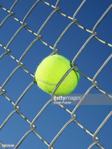 tennis ball stuck in fence - trapped stock pictures, royalty-free photos & images