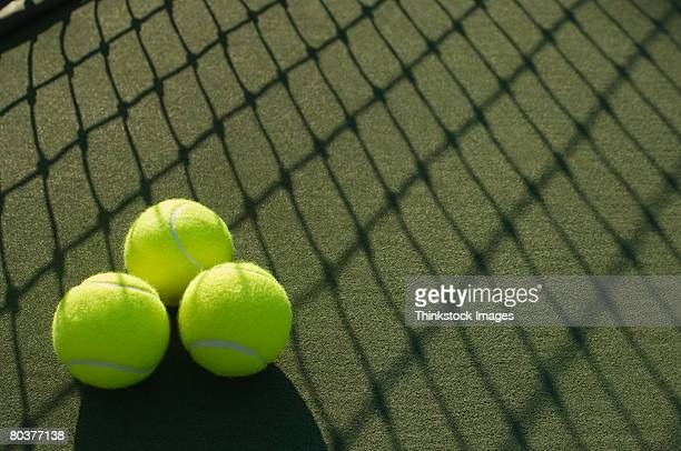 tennis balls and net shadow - thinkstock stock photos and pictures