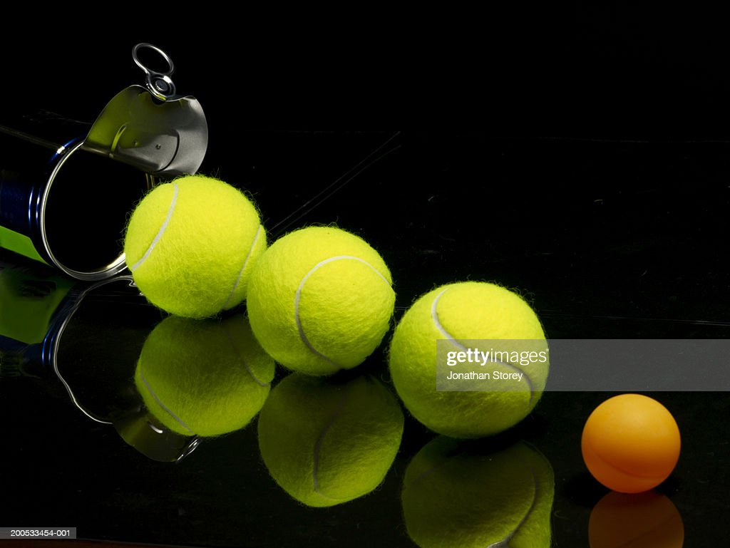 Tennis Balls And Table Tennis Ball With Can Against Black Background