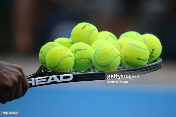 Tennis balls are seen on the racquet of Serena Williams of the United States during a practice session on day eight of the 2016 Australian Open at...