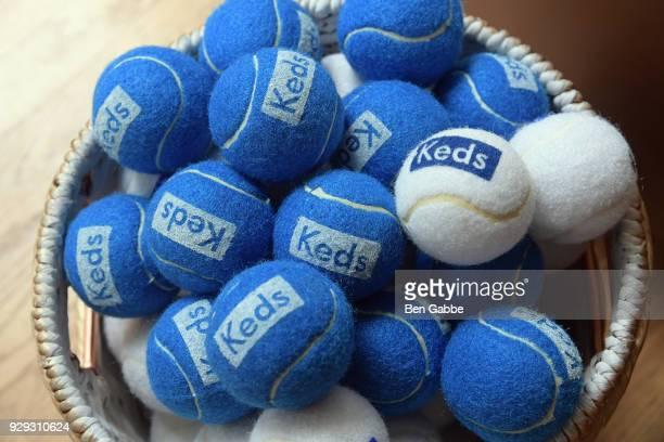 Tennis balls with Keds branding on display as Keds celebrates International Women's Day with Violetta Komyshan at Manhattan Plaza Racquet Club on...