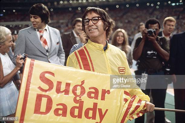 Tennis Battle of Sexes Closeup of Bobby Riggs with SUGAR DADDY sign before match vs Billie Jean King at Astrodome Houston TX 9/20/1973