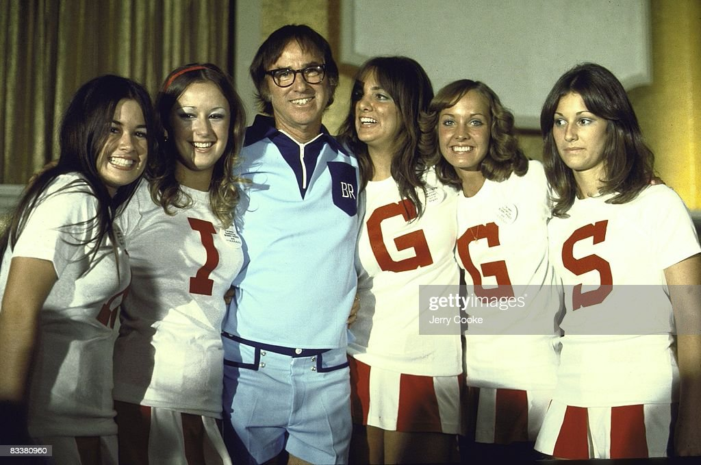 Portrait of Bobby Riggs with women with letters on their shirts that spell out R-I-G-G-S before match vs Billie Jean King at Astrodome. Houston, TX 9/20/1973