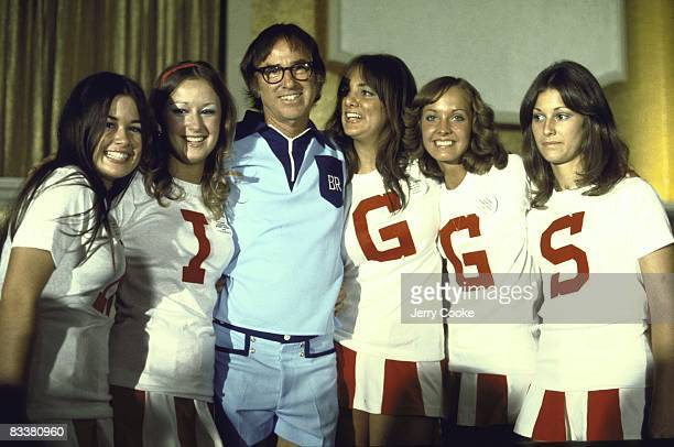 Battle of Sexes Portrait of Bobby Riggs with women with letters on their shirts that spell out RIGGS before match vs Billie Jean King at Astrodome...