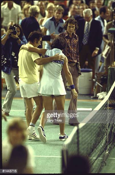 Tennis Battle of Sexes Rear view of Billie Jean King and Bobby Riggs walking off court after match at Astrodome King won match Houston TX 9/20/1973