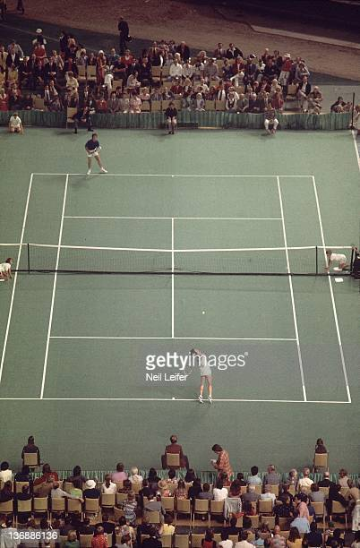 Tennis Battle of the Sexes Aerial view of Billie Jean King in action serve vs Bobby Riggs during match at Astrodome Houston TX 9/20/1973 CREDIT Neil...