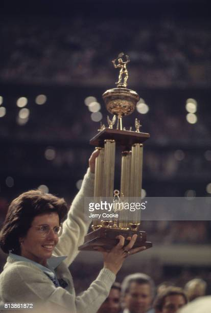 Battle of the Sexes II Billie Jean King victorious with trophy after winning match vs Bobby Riggs at the Astrodome Houston TX CREDIT Jerry Cooke
