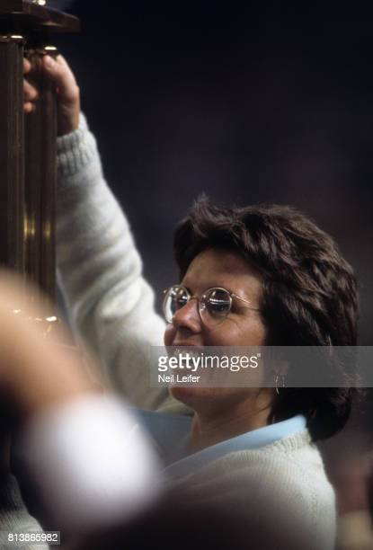 Battle of the Sexes II Billie Jean King victorious with trophy after winning match vs Bobby Riggs at the Astrodome Houston TX CREDIT Neil Leifer