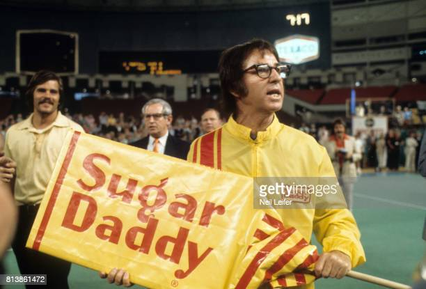 Battle of the Sexes II Bobby Riggs holding oversized Sugar Daddy candy bar before match vs Billie Jean King at Astrodome Houston TX CREDIT Neil Leifer