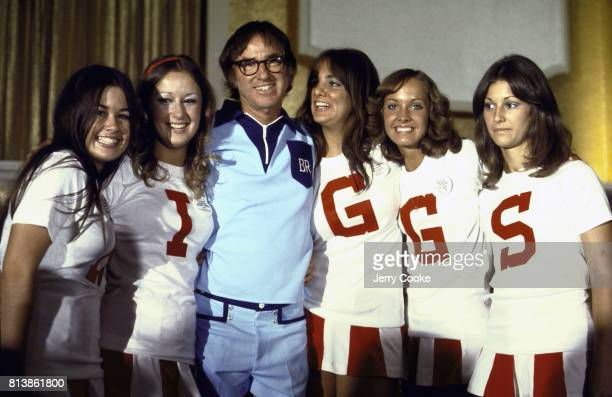 Battle of the Sexes II Portrait of Bobby Riggs with women with letters on their shirts that spell out RIGGS before match vs Billie Jean King at...