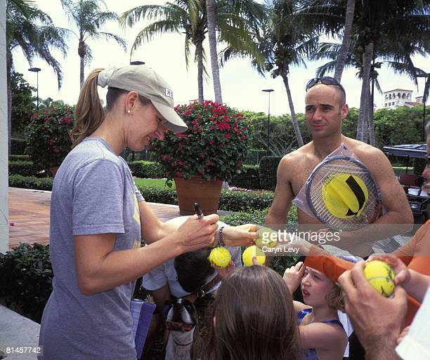 Tennis Casual portrait of Andre Agassi and girlfriend Steffi Graf signing autographs for youth fans Fisher Island FL 1/1/2000