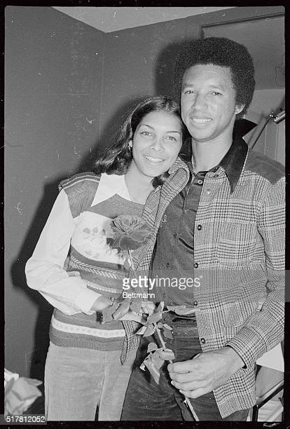 Tennis champion Arthur Ashe and his fiancee, Jeanne Marie Moutoussamy share a tender moment at her apartment here February 16, following reports that...