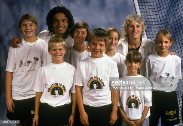 Tennis champion Yannick Noah and mother Marie Claire with Les Enfants de la Terre, on September 30, 1990 in Toulouse, France.
