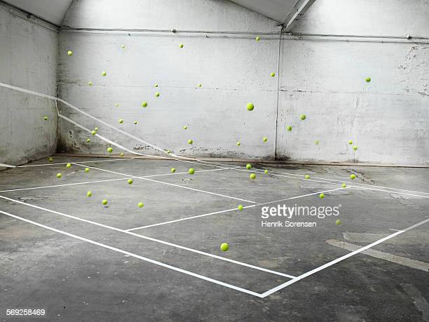 Tennis court filled with tennis balls