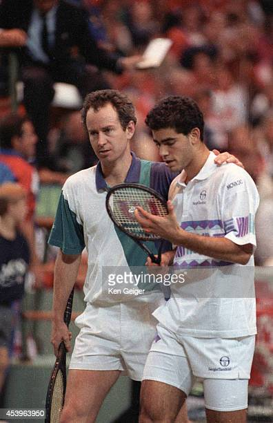 Davis Cup USA John McEnroe and Pete Sampras during Doubles Final vs Switzerland Jacob Hlasek and Marc Rosset at Tarrant County Center Fort Worth TX...