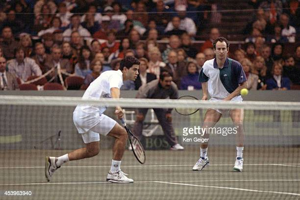 Davis Cup USA John McEnroe and Pete Sampras in action vs Switzerland Jacob Hlasek and Marc Rosset during Doubles Final at Tarrant County Center Fort...