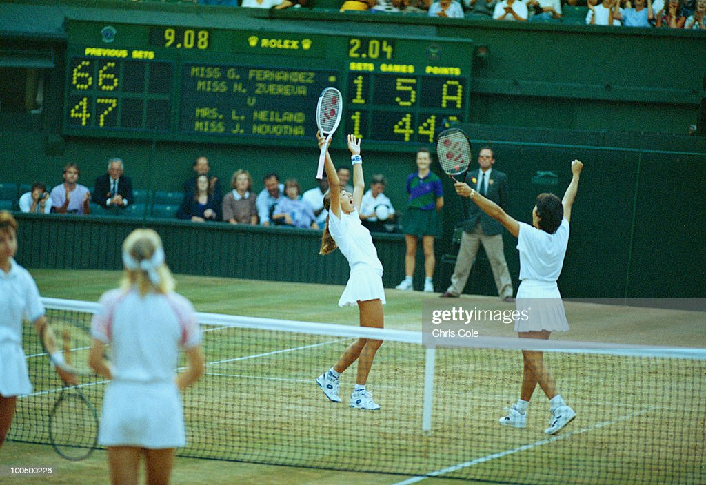 Tennis doubles partners Gigi Fernandez (right) and Natasha Zvereva celebrate their victory over Jana Novotna and Larisa Neiland in the final of the Women's Doubles at Wimbledon, 1993. Fernandez and Zvereva won the match 6-4, 6-7(9), 6-4.