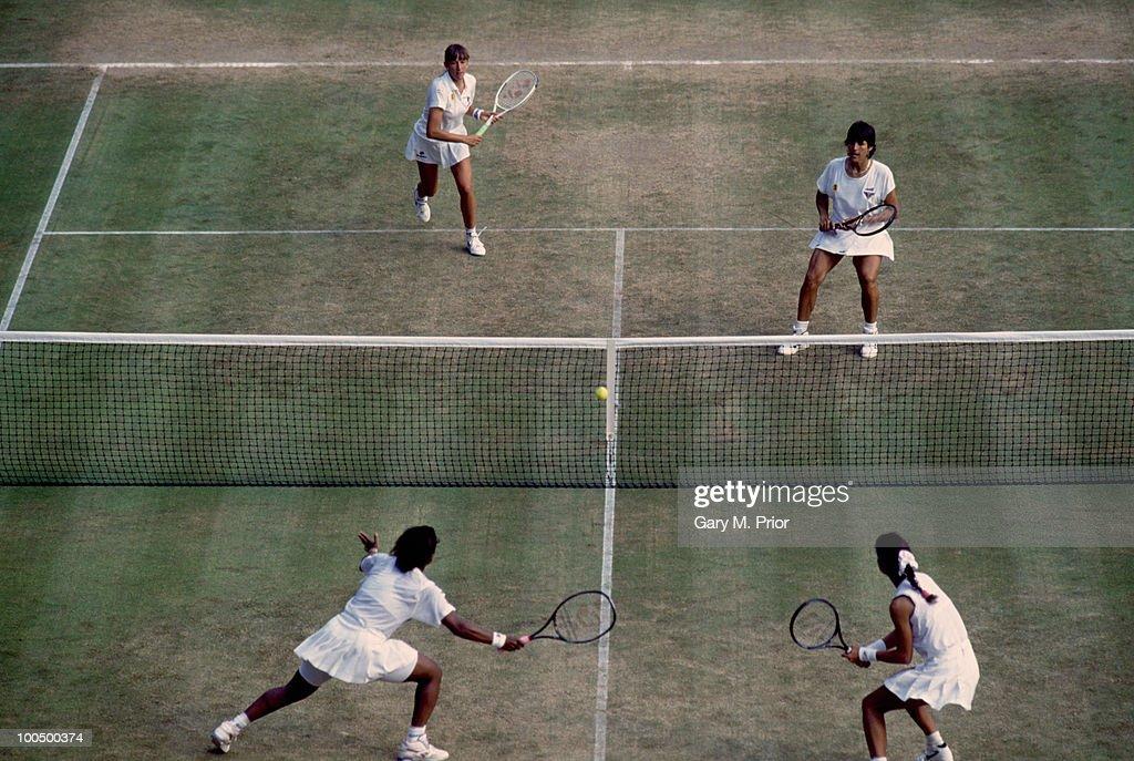 Tennis doubles partners Natasha Zvereva (top left) and Gigi Fernandez (top right) in play against Zina Garrison and Mary Joe Fernandez in the Women's Doubles at Wimbledon, 1993. Fernandez and Zvereva went on to win the Women's Doubles tournament.