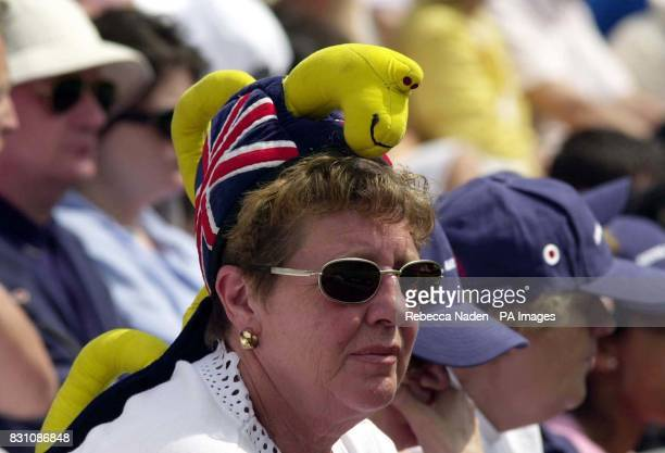 A tennis fan on Centre Court watches the match between Wimbledon champion Pete Sampras of the US and Jiri Vanek of the Czech Republic during the...