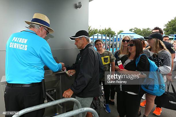 A tennis fan scans his ticket as he arrives at Melbourne Park during day one of the 2015 Australian Open at Melbourne Park on January 19 2015 in...