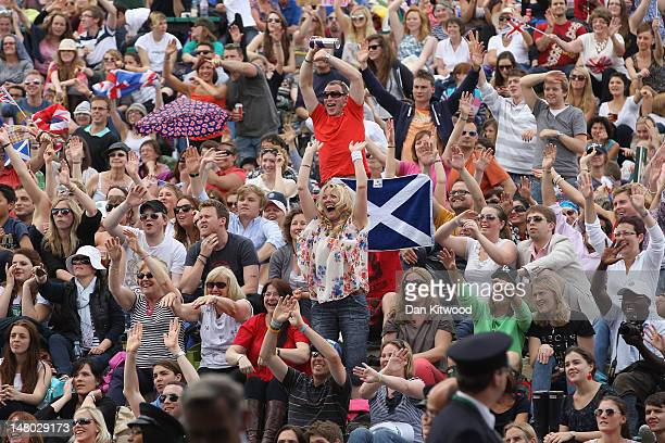 Tennis fans celebrate Andy Murray's first set win on 'Murray Mount' on the final day at Wimbledon on July 8 2012 in London England Andy Murray is the...