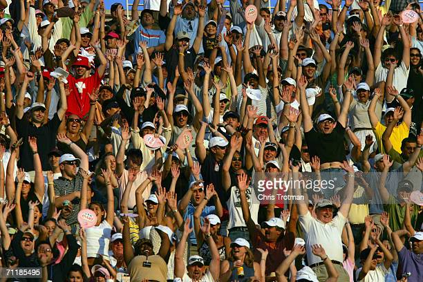 Tennis fans celebrate during the men's final of the US Open at the USTA National Tennis Center in Flushing Meadows Corona Park on September 11 2005...