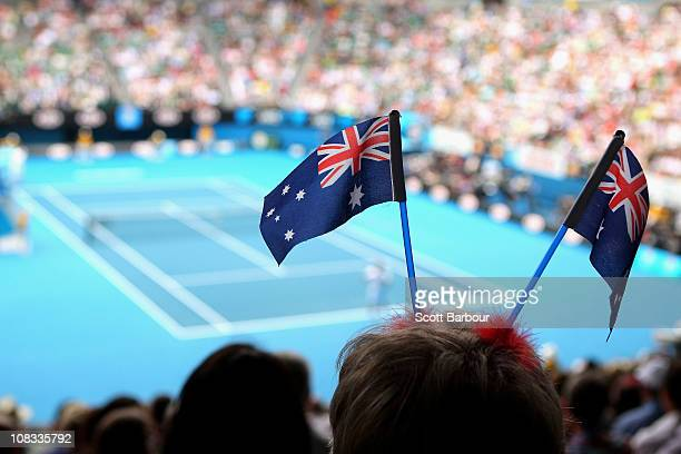 A tennis fans celebrates Australia Day at Rod Laver Arena during day ten of the 2011 Australian Open at Melbourne Park on January 26 2011 in...