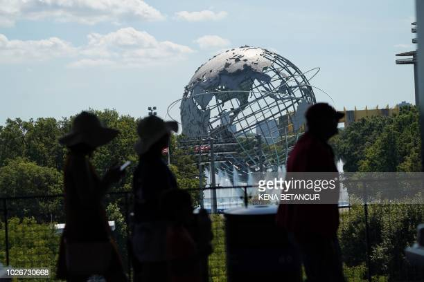Tennis fans make their way through the courtyard prior to the beginning of play in the 2018 US Open Tennis Tournament on September 4 2018 in New York