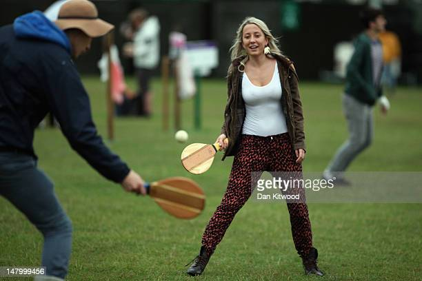 Tennis fans play bat and ball at a makeshift campsite for fans queueing for a space on 'Murray Mount' to watch the mens final tomorrow at Wimbledon...