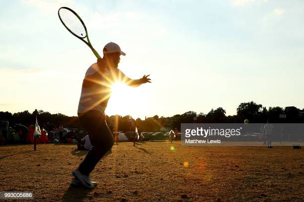 Tennis fans play tennis in the queueing zone camp site on day five of the Wimbledon Lawn Tennis Championships outside the All England Lawn Tennis and...