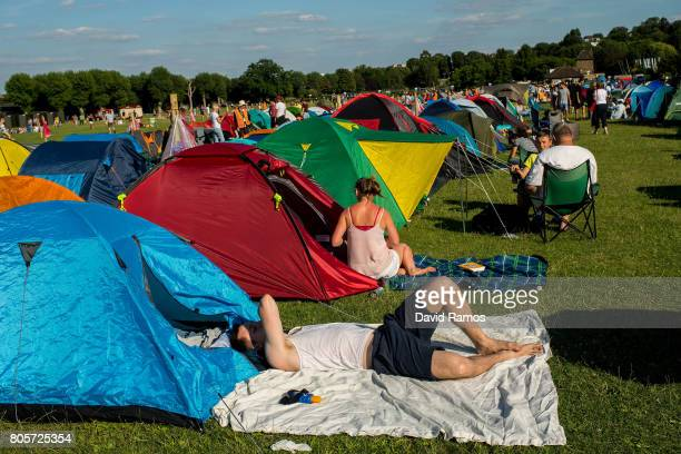 Tennis fans queue by their tents in the public queueing zone outside the All England Tennis Club at Wimbledon on July 2 2017 in London England