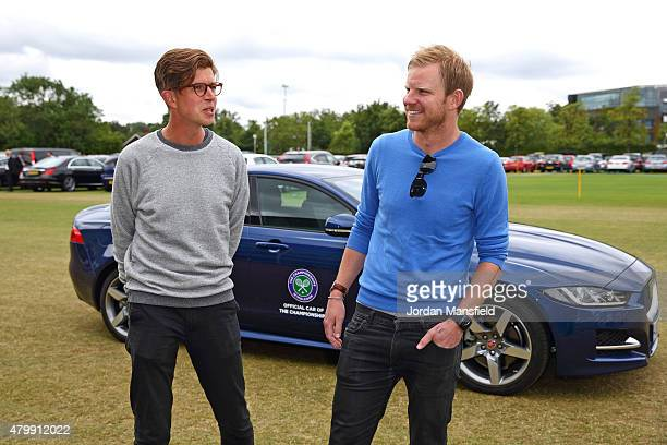 Tennis fans Tom Payne and Nick Webb chat in front of the Jaguar XE after being chauffeured to Wimbledon by 3-time Wimbledon Champion John McEnroe as...