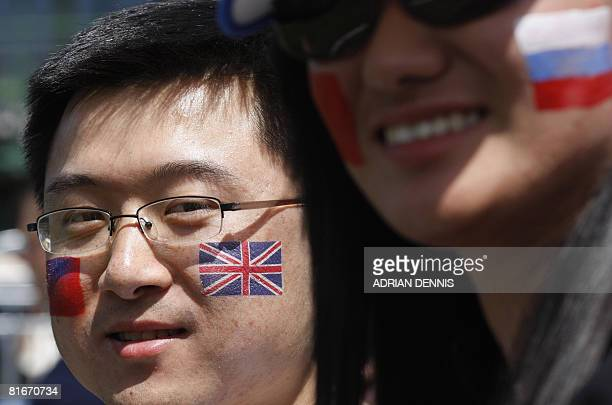 Tennis fans watch a game between China's Jie Zheng and Slovakia's Domenika Cibulkova during the first round of the 2008 Wimbledon championships at...