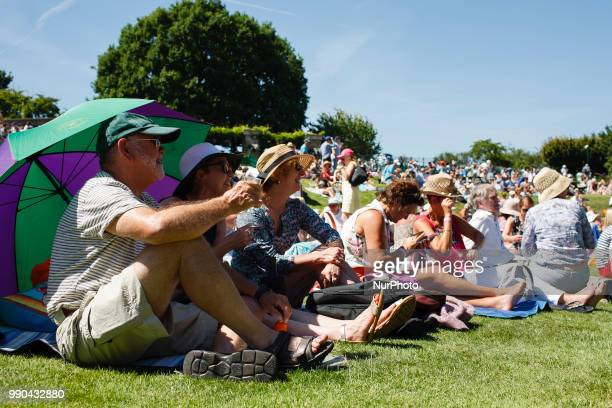 Tennis fans watch play on the big screen outside Centre Court from the fan viewing area popularly known as 'Henman Hill' on the opening day of the...